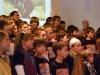 3-singende-kinder-mit-lehrern